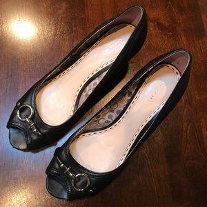 Size 10. Black Coach peep-toe Leather wedge